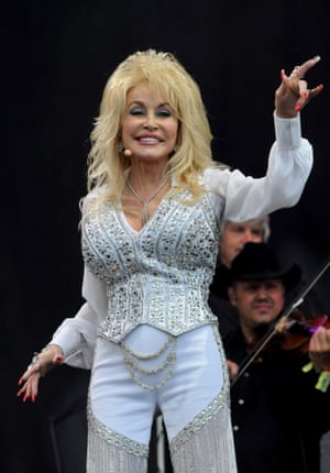 Dolly Parton brings her tried and tested formula - big hair, rhinestones, nails and smiles - to the Glastonbury stage in 2014.