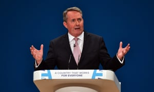 Liam Fox speaking at a podium at the Conservative party conference