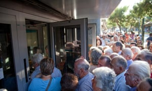 Crowds trying to enter Greek banks in Athens in July.
