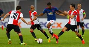 Lone striker Marcus Rashford takes on Feyenoord's Eric Botteghin, Karim El Ahmadi and Steven Berghuis.