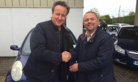 David Cameron shakes hands with Iain Harris, of Witney Used Car Centre.