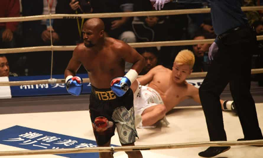 Floyd Mayweather knocks down kickboxer Tenshin Nasukawa during their exhibition boxing match at Saitama Super Arena.