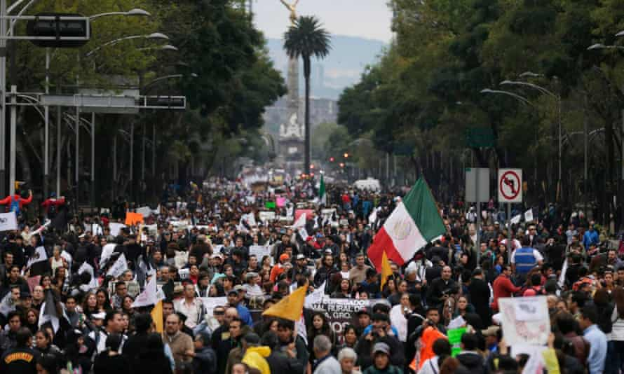 Demonstrators march on Reforma Avenue during a protest in support of 43 missing Ayotzinapa students in Mexico City.