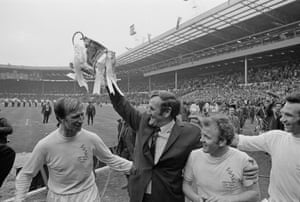 Charlton (left) celebrating with manager Don Revie and Billy Bremner at Wembley after Leeds beat Arsenal to win the FA Cup Final in 1972.