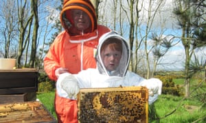 Norman Walsh with his grandson looking after the hives