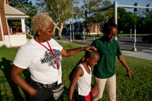 Chante Bass, from left to right, talks her son, Taron Henton, 7, and daughter, Tajaé Redden, 13, as they play outside their home in St. Louis on Thursday, Sept. 12, 2019. The family lives in north St. Louis, which has long been plagued by gun violence. At least 13 children have died of gunshot wounds in St. Louis city this year, and six children in St. Louis Country have been killed by gunfire.
