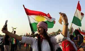 A Syrian Kurd takes a selfie in the north-eastern city of Qamishli during a gathering in support of the independence referendum in Iraq's autonomous northern Kurdish region