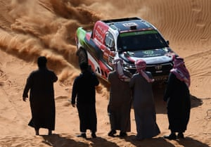 Spectators film Toyota's driver Yazeed Al Rajhi and co-driver Dirk Von Zitzewitz