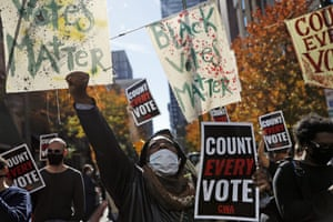 Demonstrators call for all votes to be counted during a rally outside the Pennsylvania convention centre in Philadephia