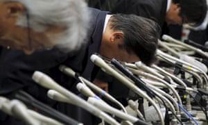 Mitsubishi Motors Corp's President Tetsuro Aikawa bows deeply