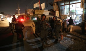 Afghan security forces stand at the site of an attack at a Shiite mosque in Kabul.