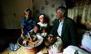 Ethiopian family sharing meal
