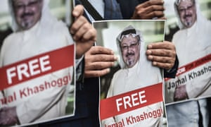 Protesters in Istanbul hold pictures of missing journalist Jamal Khashoggi on Monday.