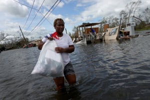 A woman rescues items from her home after it was destroyed by Hurricane Ida.