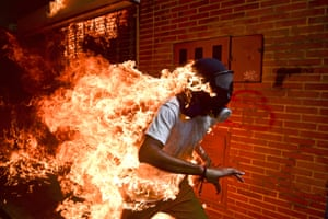 World Press Photo of the year 2018. José Victor Salazar Balza, 28, catches fire amid violent clashes with riot police during a protest against the Venezuelan president, Nicolás Maduro, in Caracas. This photo also won first prize in the spot news – singles category