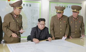 Video released by North Korea apparently shows Kim Jong-un receiving a briefing in Pyongyang on his military's plans to launch missiles in waters near Guam.