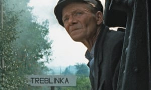 A still from Shoah, 1985, showing the driver of a train on its way to Treblinka death camp
