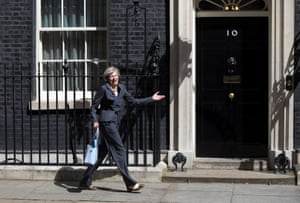 Theresa May reacts after walking to the wrong car following a cabinet meeting at Downing Street on 12 July