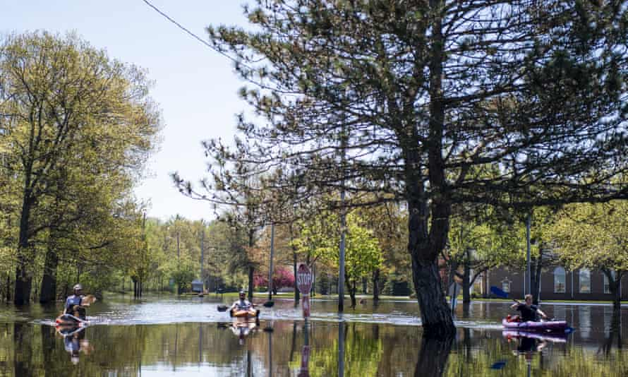 Streets are flooded as the result of a climate change event that has transformed societies