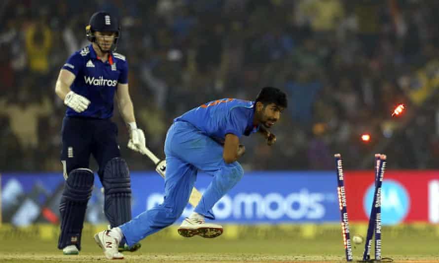 India's Jasprit Bumrah runs out England's Eoin Morgan.