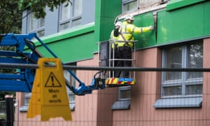 Cladding is removed from a tower block in Sheffield.