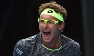 Denis Istomin celebrates his win over Novak Djokovic in Melbourne on Thursday