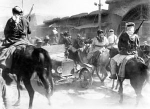 Mounted Sharifan irregulars riding through the dusty streets of Damascus soon after the capture of the city in October 1918.