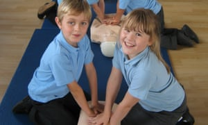 Two children pose during CPR training