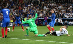 Antoine Griezmann prods the ball past Neuer.