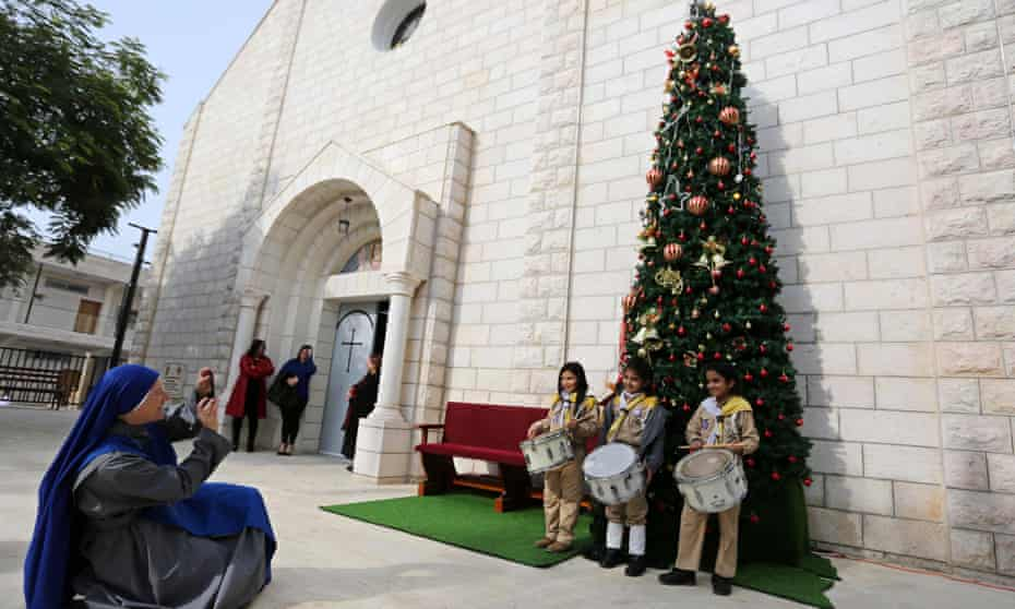Palestinian Christians at the Holy Family Church in Gaza City before mass this month.