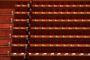 Hostesses prepare drinks before a conference at the Great Hall of the People in Beijing, China