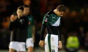 Plymouth Argyle's Oscar Threlkeld looks dejected after the game.