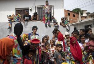 People dressed in devil costumes celebrate the Catholic holiday of Corpus Christi in Naiguata.