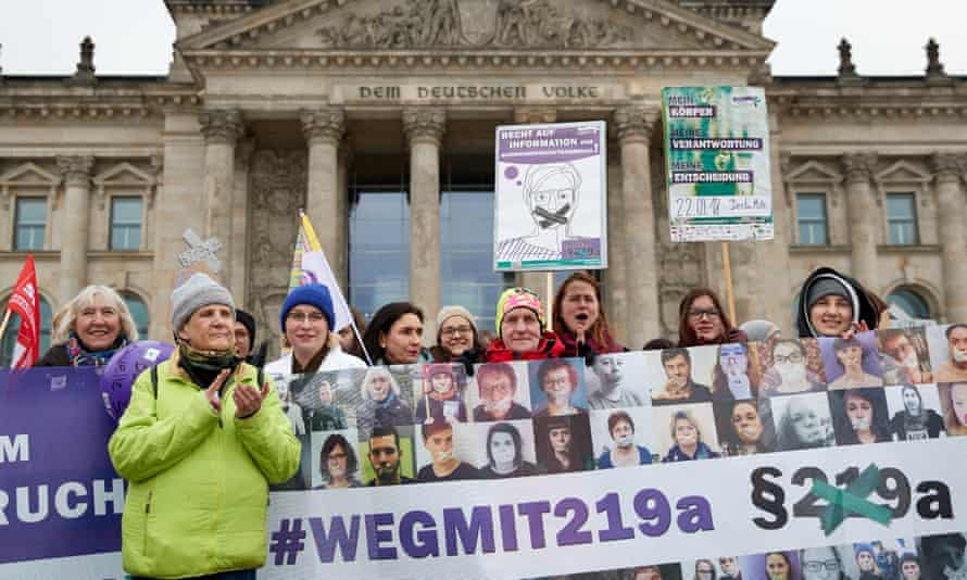 Women stage a protest against Germany's abortion laws in front of the Reichstag building in Berlin