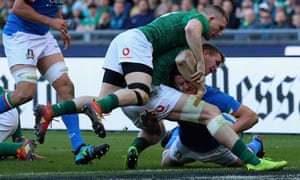Luca Morisi of Italy scores the team's second try