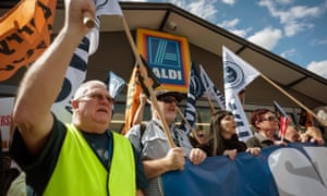 Union members protest outside an Aldi supermarket in Mount Druitt, Sydney