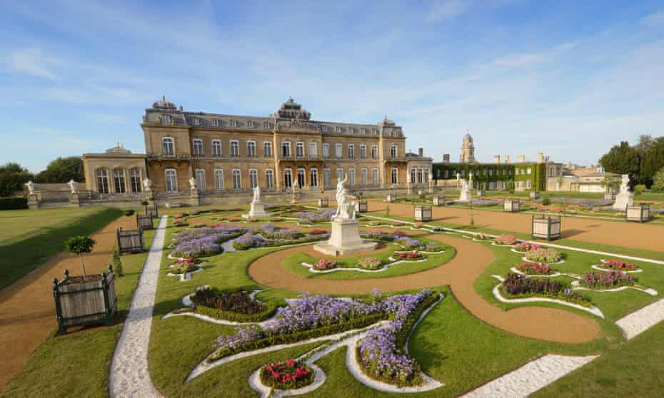 Landscape view of Wrest Park estate and gardens, Bedfordshire, UK, on a blue-sky day.