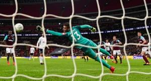West Ham goalkeeper Adrian is beaten for the second Spurs goal.