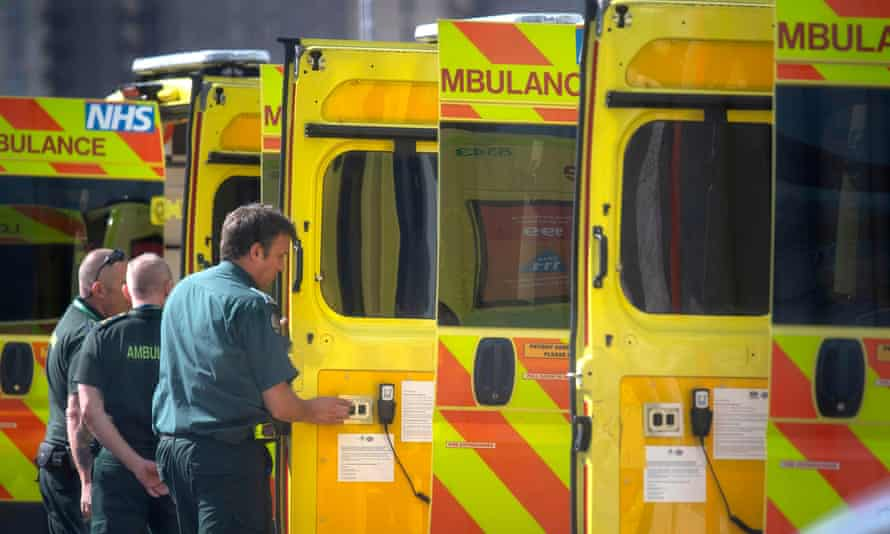 NHS workers prepare a line of ambulances outside at the NHS Nightingale Hospital at the Excel Centre in London