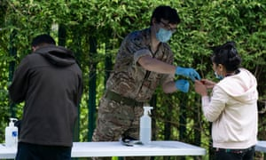 A member of the military  conducts Covid-19 testing in Leicester on Wednesday