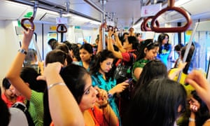 A women-only carriage on the Delhi metro, where fares have doubled since 2017.