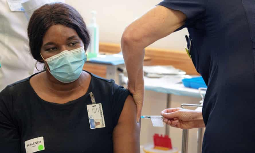 A South African health worker receives the Johnson and Johnson vaccination at Khayelitsha Hospital near Cape Town.