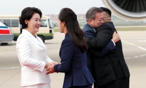 Moon Jae-in and his wife Kim Jung-sook are greeted by Kim Jong-un and his wife Ri Sol-ju