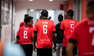 Team Syria walk out for the final of the Communities World Cup at St. George's Park