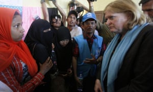 Anne Richard, the assistant secretary of state for population, refugees and migration, right, talks to Rohingya migrants during her visit to a temporary shelter in Kuala Cangkoi, Indonesia, on Tuesday.