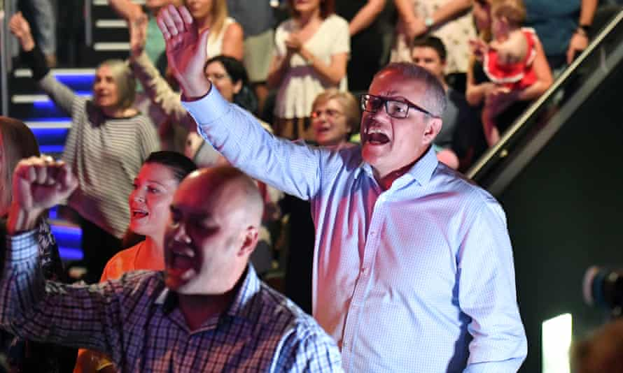 Scott Morrison sings during an Easter Sunday service at Horizon church at Sutherland.