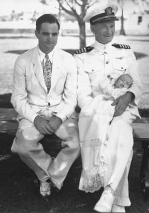 John McCain in the arms of his grandfather, John Sidney McCain, right, His father John Sidney McCain Jr. is at left. Panama Canal Zone 1936.