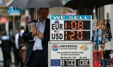 A board illustrates currency exchange rates in London