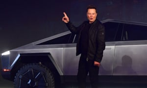 """Elon Musk gestures while introducing the newly unveiled all-electric battery-powered Tesla Cybertruck"""
