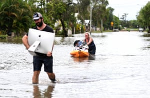 Queensland, Australia. Residents salvage items from their flood-affected homes in the suburb of Hermit Park in Townsville